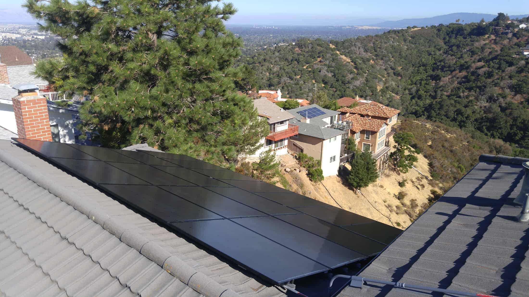 A solar installation by Michael & Sun Solar on a roof consisting of concrete tiles.