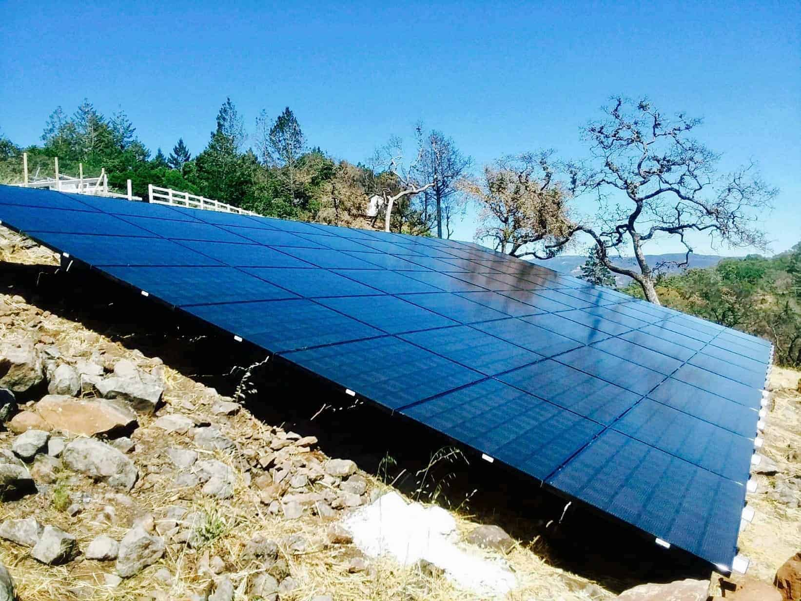A ground mount solar panel array by Michael & Sun Solar